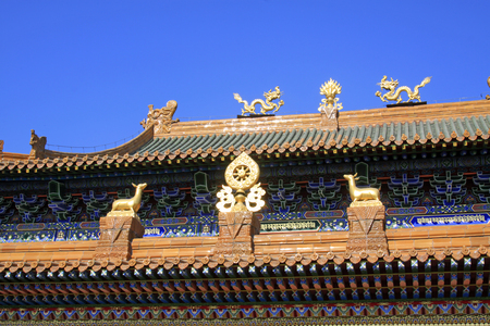 the gilding: Glazed tile roof and Gilding copper Dharma chakra in a temple, closeup of photo Stock Photo
