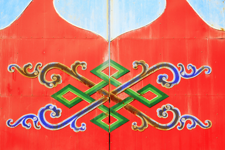 cultural artifacts: Color design on the red door plank in a temple, closeup of photo