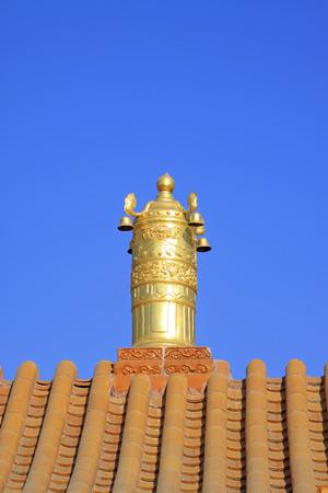 the gilding: Gilding copper Dharma chakra in a temple, closeup of photo
