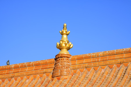 the gilding: Glazed tile roof and Gilding copper decoration in a temple, closeup of photo Stock Photo