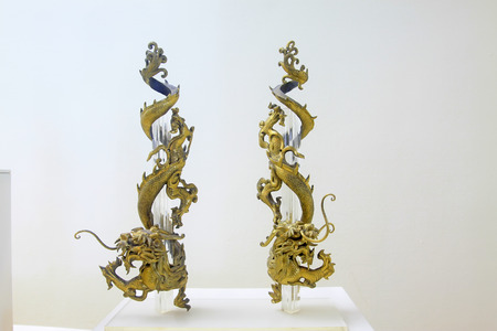 articles: copper and gold dragon decorations furnishing articles, closeup of photo Editorial
