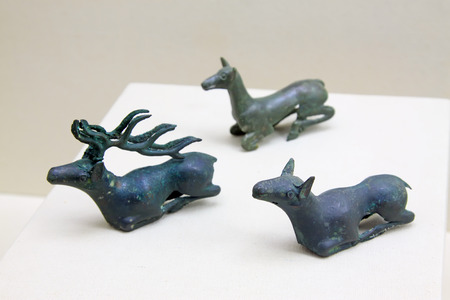 restore ancient ways: ancient Chinese bronze deer, closeup of photo Editorial