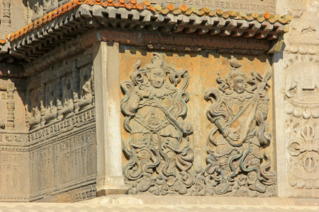 cultural artifacts: Figure and sculpture of Buddha in an ancient architectural style temple in inner mongolia