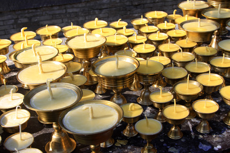 ghee: butter lamp neatly arranged, closeup of photo