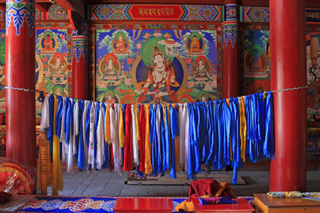 murals: Painted murals and Prayer flags in a temple, closeup of photo Editorial