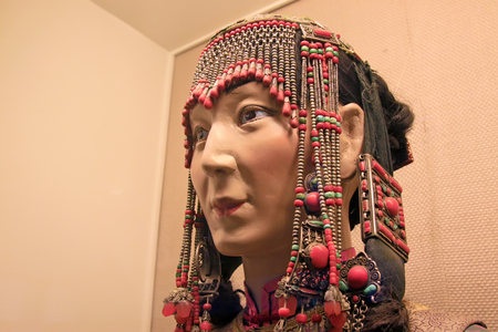 mouth cloth: traditional style mongolian face figure, closeup of photo