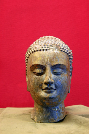 stone carvings: Stone carvings head portrait of the Buddha in a museum, closeup of photo