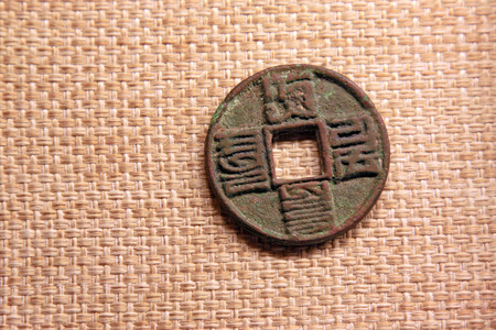 inner wear: ancient Chinese copper coin, closeup of photo Editorial
