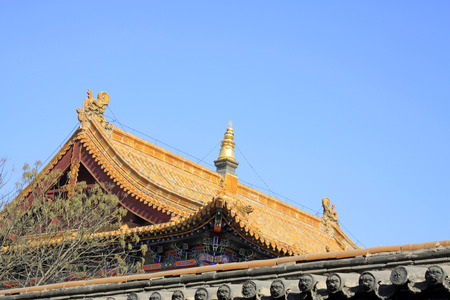 aureate: Glazed tile roof in a temple, closeup of photo
