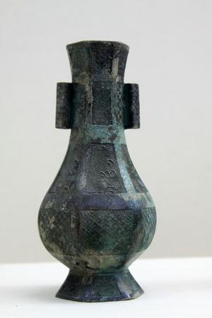 restore ancient ways: ancient Chinese bronze pot, closeup of photo Editorial