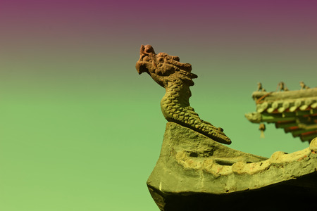 restore ancient ways: dragon modelling sculpture in a temple, closeup of photo Stock Photo