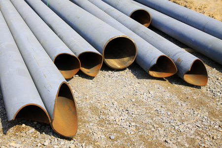 steel pipe: Steel pipe pile up on the ground, closeup of photo
