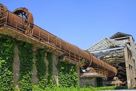 kiln: idle cement plant rotary kiln machinery, closeup of photo Editorial