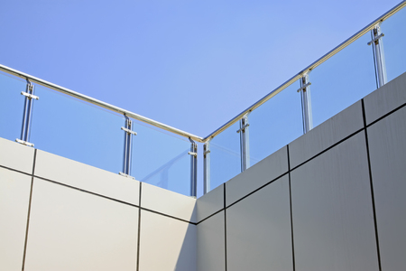 handrails: Stainless steel handrails and glass walls in a building