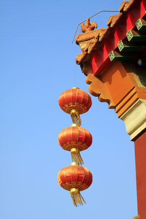 respectful: Lanterns and eaves in a temple, closeup of photo Stock Photo