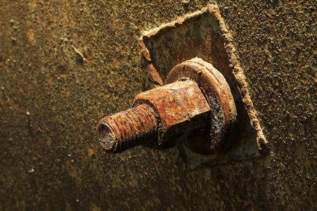 rust metal: oxidation rust metal screw, closeup of photo Stock Photo