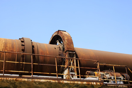corrosion: idle cement plant rotary kiln machinery, closeup of photo Stock Photo
