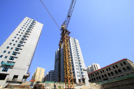 deformity: Unfinished high-rise buildings and tower crane in construction site