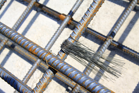 solid wire: twisted steel and binding wire in the construction site