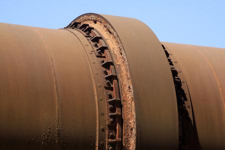 kiln: idle cement plant rotary kiln machinery, closeup of photo Stock Photo