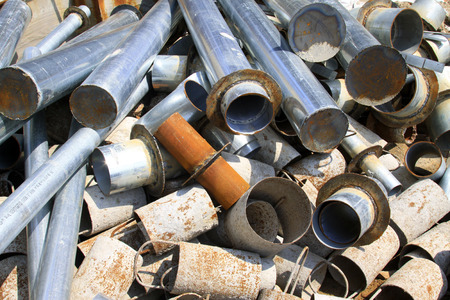 disorderly: Metal pipe piled up together in the construction site, closeup of photo Editorial