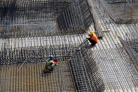 ねじ山鋼バーのフレームワークは、建設現場 写真素材