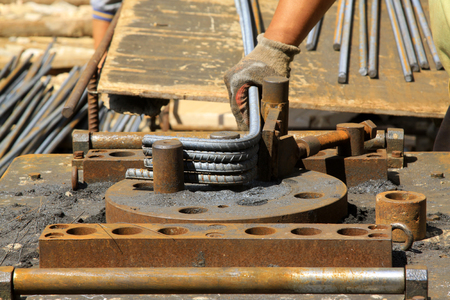 on rebar: rebar processing in the construction site Stock Photo
