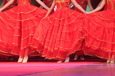 beautiful ankles: red dress on the stage, closeup of photo