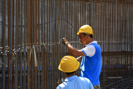 reinforcing bar: Luannan - August 21: Construction workers binding rebar in the construction site, on August 21, 2015, luannan county, hebei province, China
