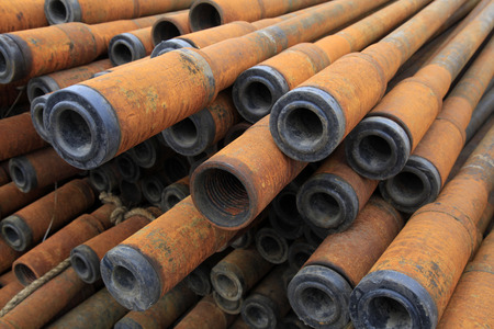 geophysical: Oil pipe piled up together, closeup of photo