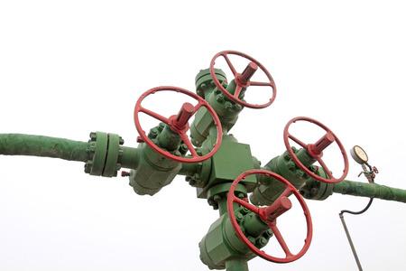 damage control: Oil pipeline control handwheel and pressure gauge, closeup of photo