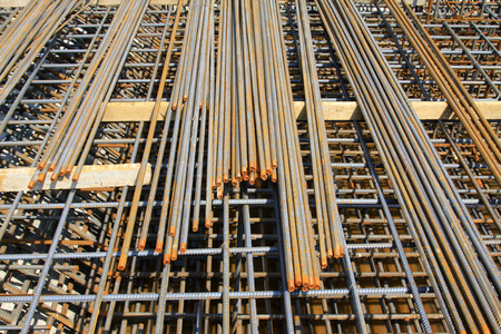 on rebar: Rebar piled up together, in the construction site