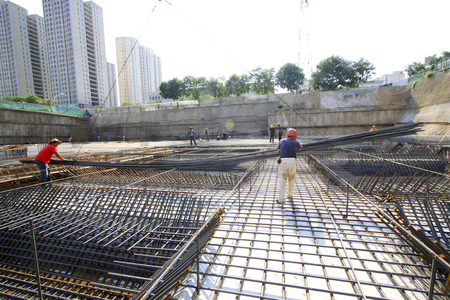 steel bar: Luannan County - August 21: workers were hoisting steel bar, in the construction site, on August 21, 2015, luannan county, hebei province, China