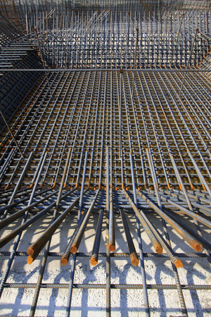 strong foundation: Screw thread steel bar framework in the construction site Stock Photo