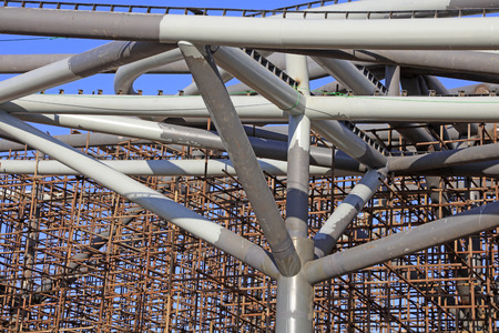 scaffold: huge steel tube and the scaffold under the blue sky Editorial