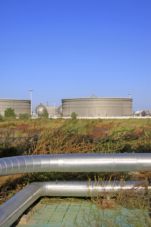 storage tanks: Caofeidian - October 1: Storage tanks and oil transmission pipeline in jidong oilfield, on October 1, 2016, caofeidian, hebei province, China