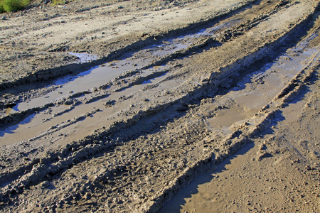 concave: muddy road, closeup of photo