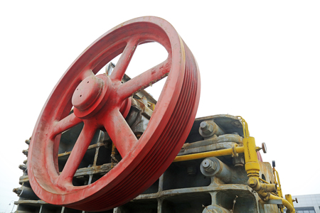 rupture: abandoned large mechanical equipment wheel, closeup of photo