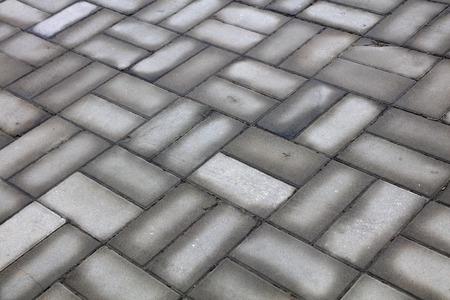 damp gray cement floor tile, closeup of photo