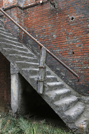 rupture: debris building stairs, closeup of photo