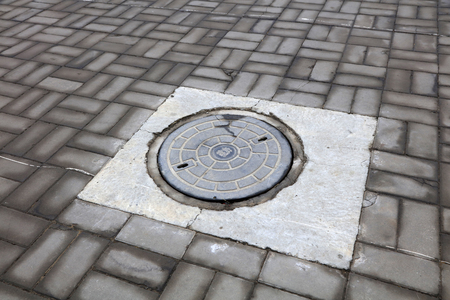 manhole cover: Metal manhole cover, closeup of photo