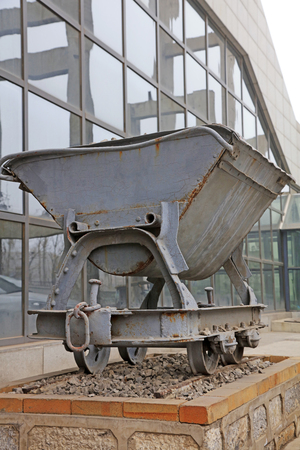hopper: Gray iron and steel hopper, closeup of photo