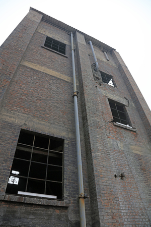 heavy risk: disused factories workshop, closeup of photo