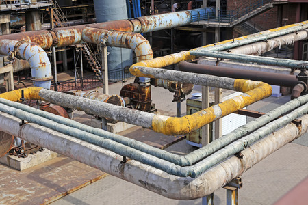 corrosion: Thermal insulation pipe and mechanical equipment in the factory, closeup of photo