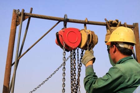 pulley: pulley sling and workers, closeup of photo