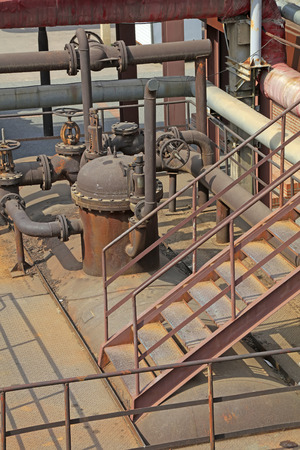 oxidize: oxidize pipeline in abandoned factory, closeup of photo