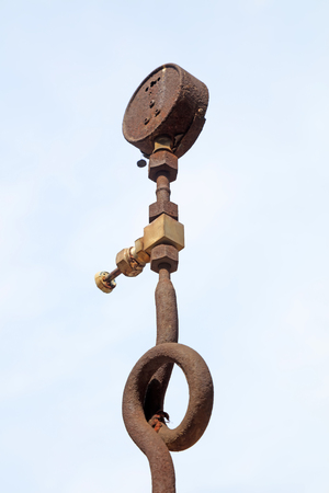 oxidize: oxidize pressure gauge and valve in the factory, closeup of photo