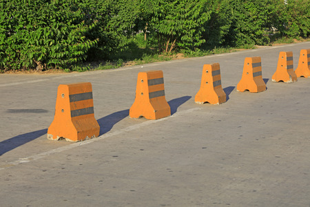parking facilities: Cement concrete traffic isolation pier, closeup of photo Stock Photo