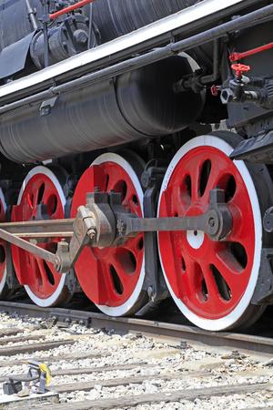 cast iron red: Steam locomotive wheel, closeup of photo