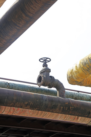 oxidize: oxidize pipeline and handwheel in a factory, closeup of photo